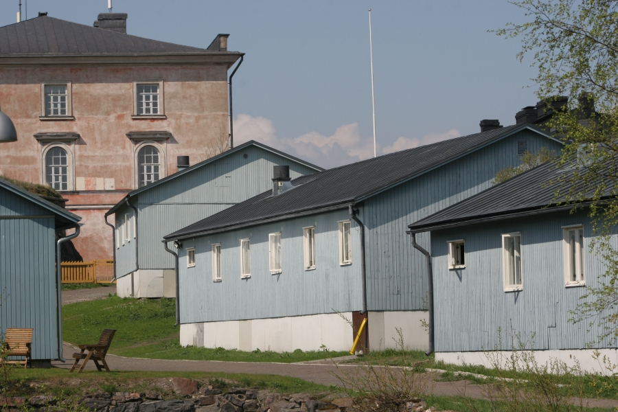 Inmates at the Suomenlinna open prison live in blue dormitory-style housing. A picket fence is all that separates the prison grounds from the rest of the island, a popular tourist destination.
