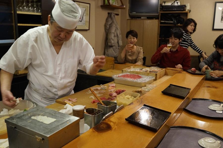 Patrons watch as Yajima-san gets to work