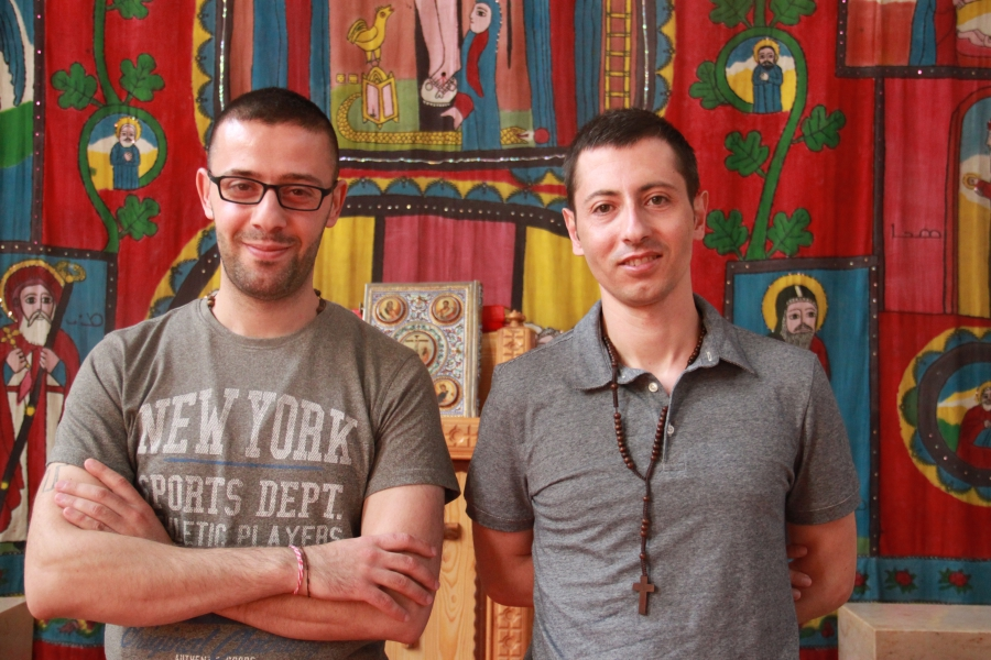 Tarek Bakhous (l) and Wassim Awad, two Syrian Christian refugees, in the Syriac Orthodox Church of Antiochia in Berlin, where the liturgy is in Syriac, a dialect of Aramaic.