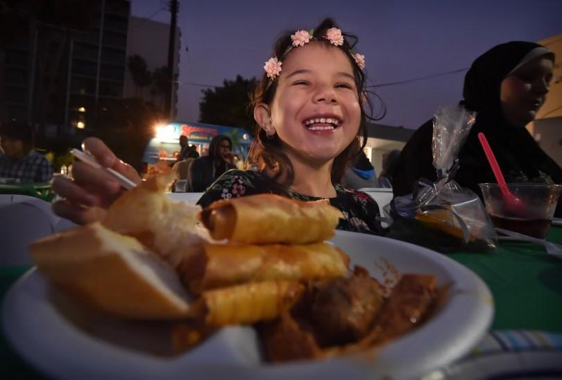 Yara Dalati, 5, of Anaheim smiles at her iftar meal