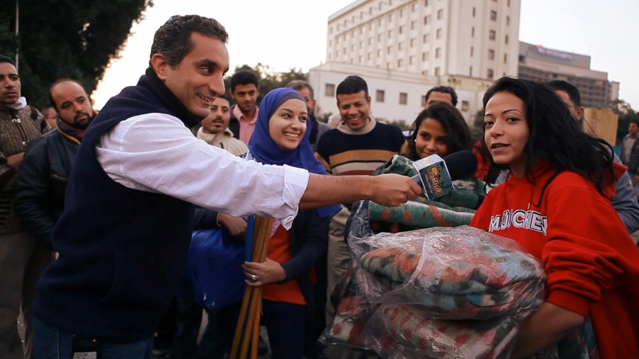 Bassem Youssef interviewing people on the streets of Cairo in the early days of his transition from a heart surgeon to a political satirist, November 2011.