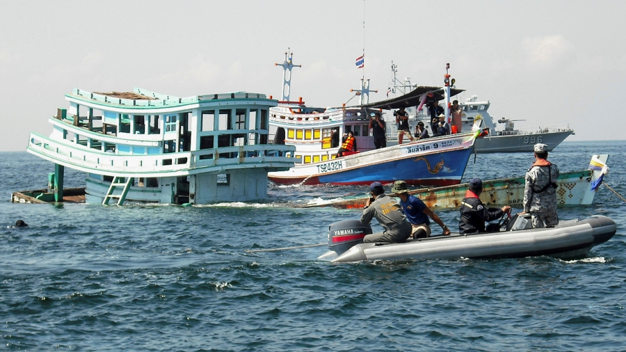An illegal fishing boat, seized by Thai officials, sinks off the coast of Phetchaburi province, Thailand.