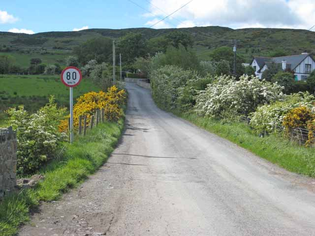 The border between the UK and the Republic of Ireland at Killeen is marked only by a road sign using the metric system.