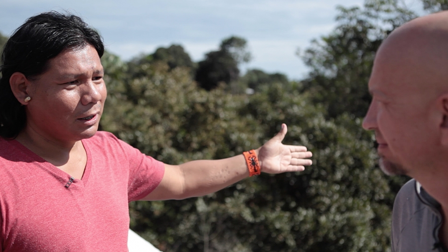 Xavante activist Hiparidi Toptiro stands on a bridge showing the border between his people's lands and the soy farms.