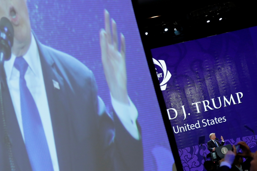 President Donald Trump appears on a large video screen as he delivers remarks at the APEC CEO Summit, Nov. 10, 2017.