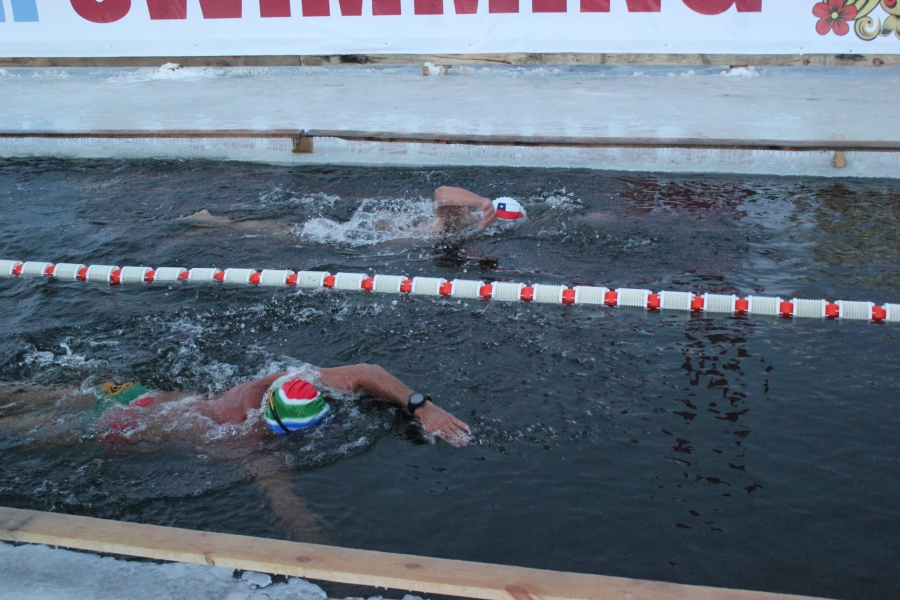 Swimming in a pool cut out of ice in Murmansk, Russia. No wet suits here.