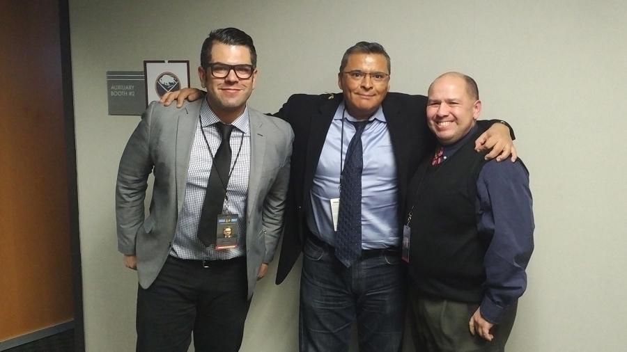 Three men in hallway