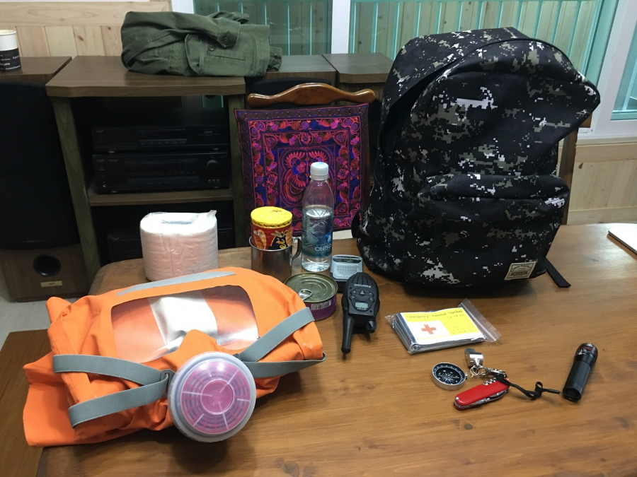 Woo Seung-yep keeps a backpack filled with emergency supplies, including canned food and a gas mask.