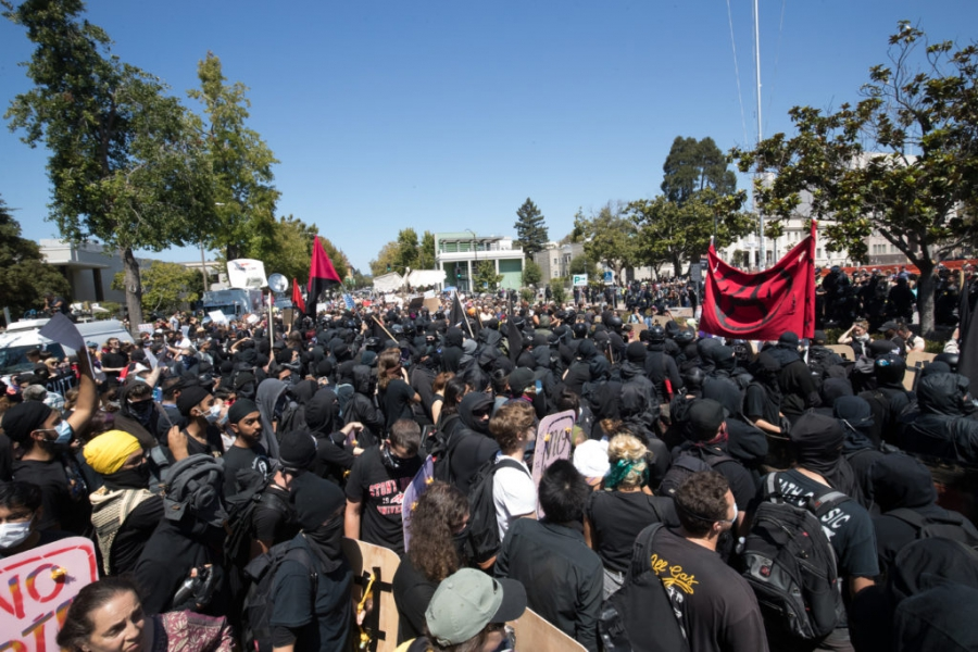 Antifa activists face off against Berkeley police, who lined up between protesters and the Martin Luther King Jr. Civic Center Park.