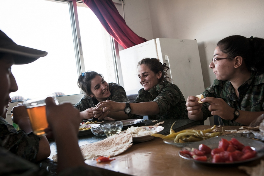 YPJ soldiers have breakfast at their post in Syria.