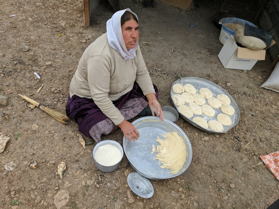 Wadha Khalaf makes bread for her family on Mount Sinjar.