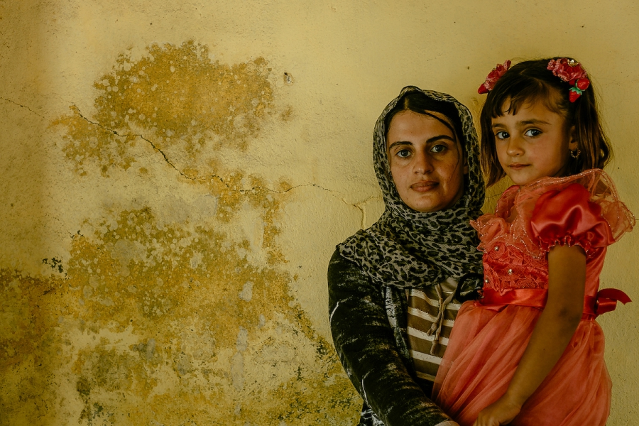 Turkia Hussein, 25, and her 2-year-old daughter Riwazi.