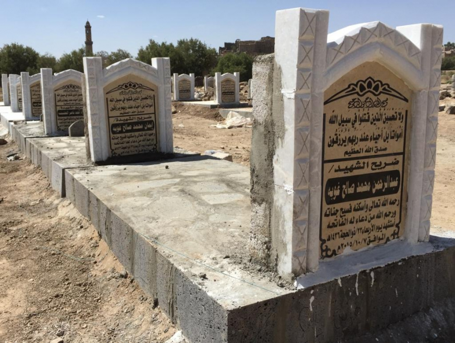 Twenty-six new graves outside the now-ruined home of the al-Sanabani family. All together 43 people died when an airstrike tore through a wedding party on Oct. 7.