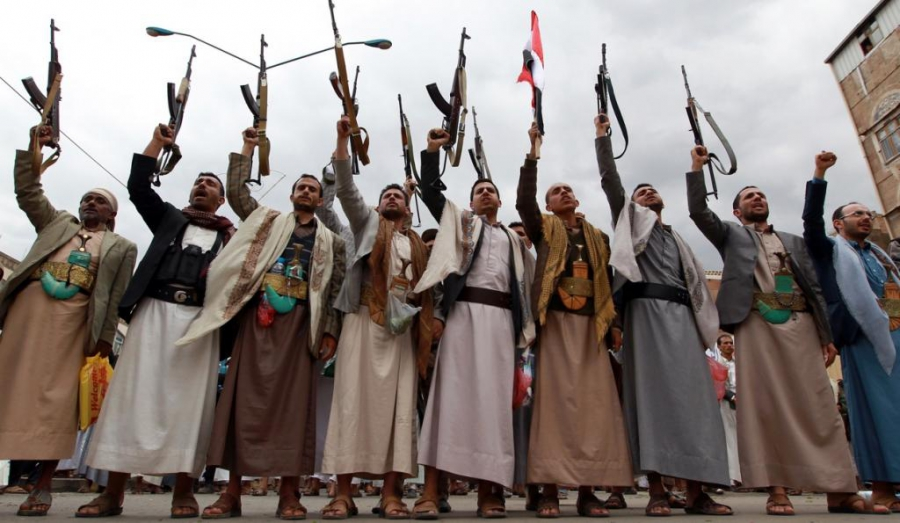Houthi gunmen brandish their weapons on March 26 in Sanaa.