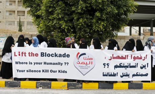Healthcare workers demonstrate against the blockade outside the UN headquarters in Sanaa.