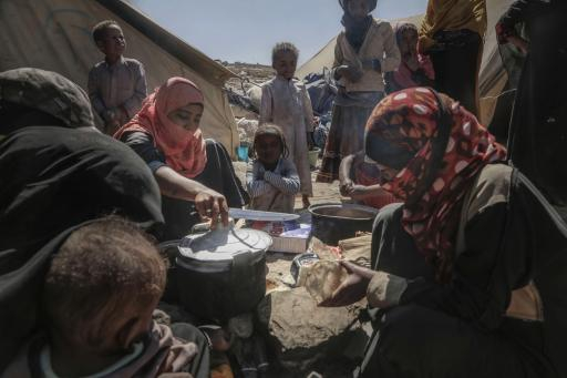 A displaced family burns plastic bottles, a toxic hazard, to cook a precious meal. They know it's not good for them, but there is no coal or wood in the area. Humanitarian aid rarely reaches them.