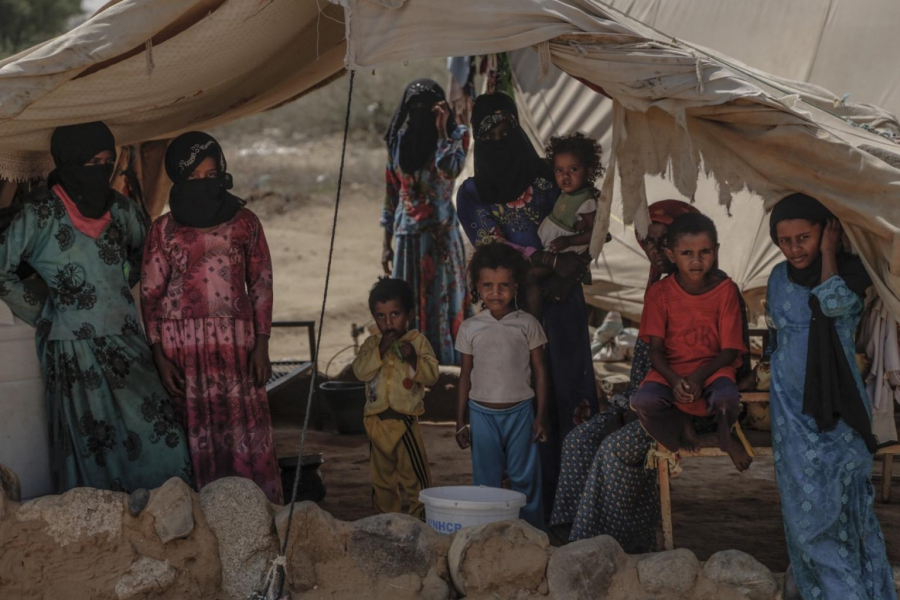 A family stands inside their tent in Beni Hassan, Hajjah. In December, the United Nations said more than 2.5 million had been forced from their homes in Yemen.
