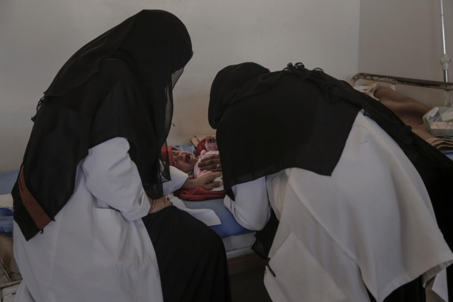 Nurses at the malnutrition clinic of al-Gomhouri hospital in Sadaa attend to a 4-month-old. There are only five working malnutrition clinics in the country.