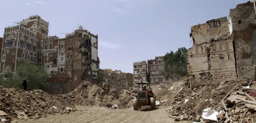 Yemenis clear the rubble of houses in the old city of Sanaa, a UNESCO-listed heritage site, on June 15, 2015, after an airstrike.