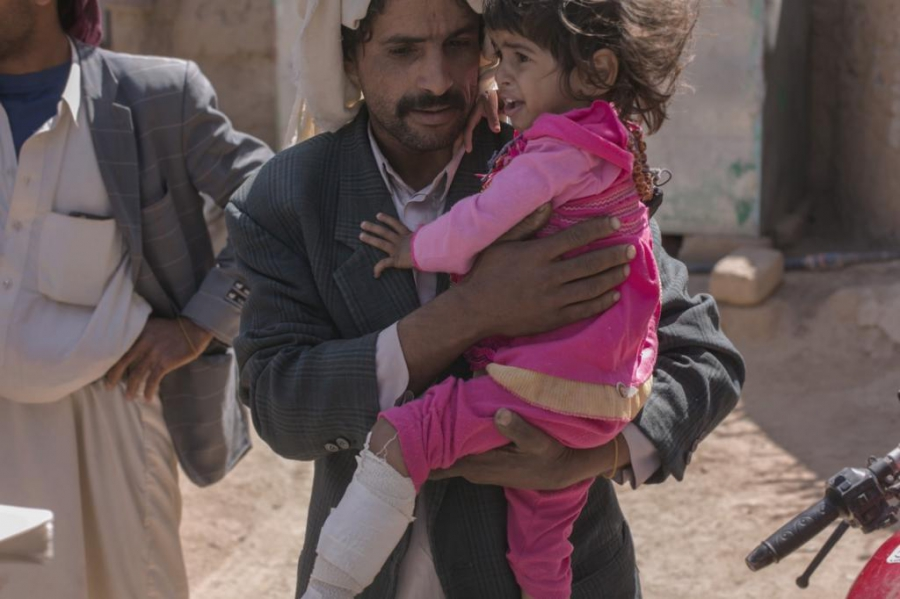 Hasna Al-Hanash, 3, and her Father. Hasna was injured alongside her grandmother when unexploded cluster munitions fell all around them.