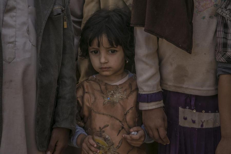 Fatima, 2, stands between her four siblings in northern Yemen.