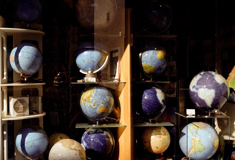 Globes in a shop window.