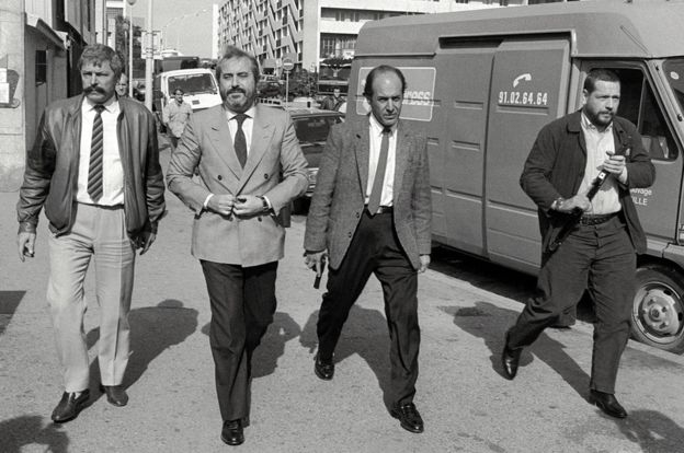 Judge Giovanni Falcone (second from left) with bodyguards during a visit to Marseilles