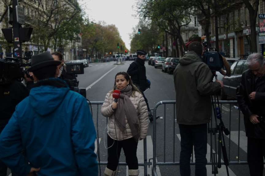 Reporters at work a few hundred meters from the Bataclan concert hall in Paris on Saturday afternoon.