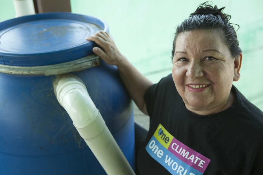 Terezinha da Silva with one of the her signature rain barrels.