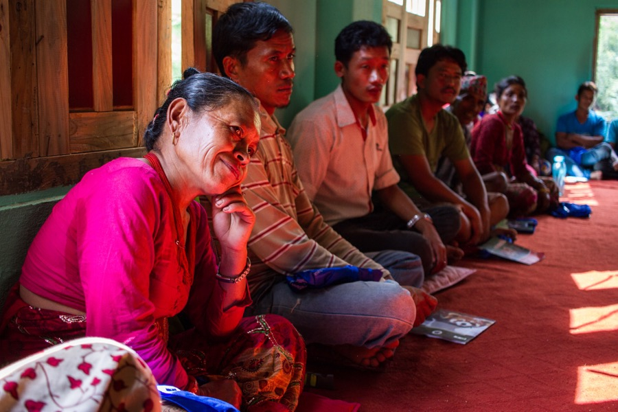 Residents of Ichok listen to a micro-enterprise training at Partnership Nepal in Sindupalchok.