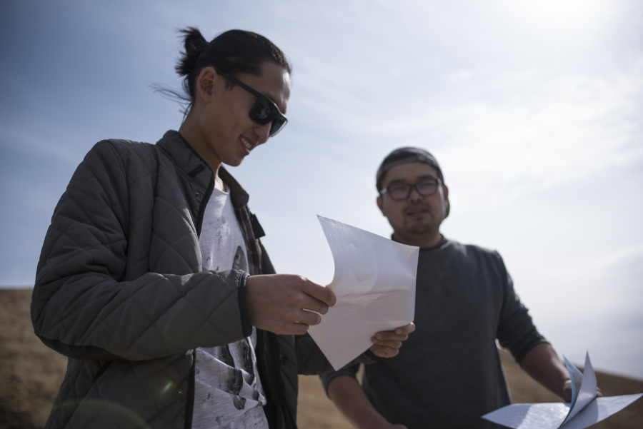 Activists Tuguldur Chuluunbaatar, left, and Batdorj Gongor, right, map environmental and social conditions in the ger district to rally support for change. Photo by Shane Thomas McMillan
