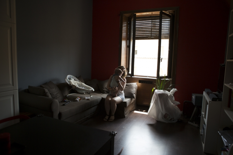 Estella, 25 and unemployed, rocks her four-month-old insider her Rome apartment. It's one of dozens inside a building occupied by CasaPound, Italy's biggest neo-Fascist movement.