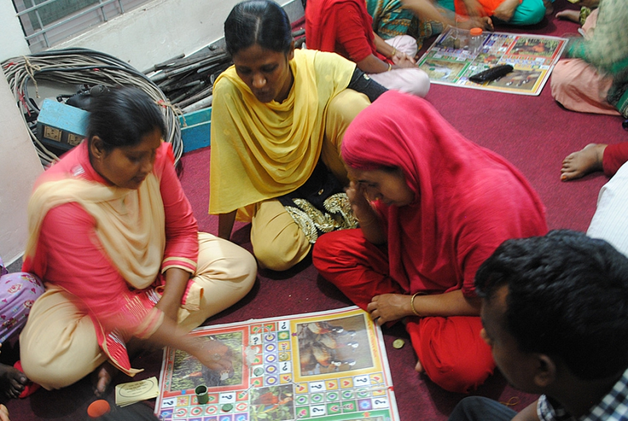 """Garment workers in Dhaka gather at a """"women's cafe"""" after work to learn about workers' rights and responsibilities."""