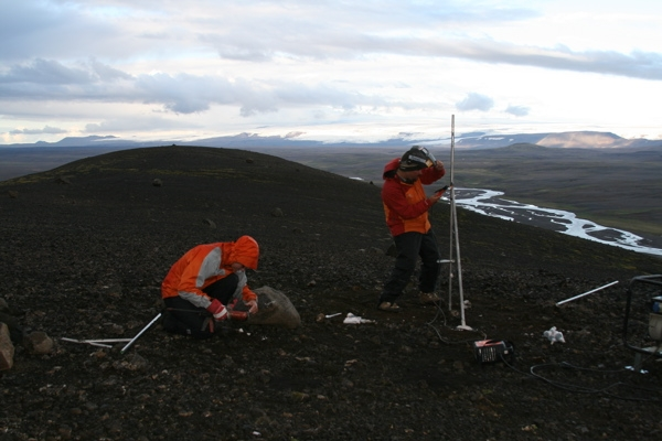 """Scientists setting up GPS sensors to measure """"accelerated uplift"""" in Iceland."""
