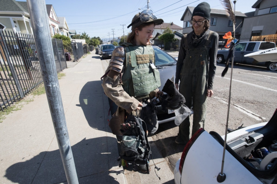Antifa members Vincent Yochelson, left, and John Cookenboo pack gear for a counterprotest against a right-wing gathering Aug. 26 in San Francisco.