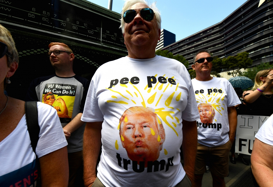 Protesters wearing shirts displaying a picture of US President Donald Trump