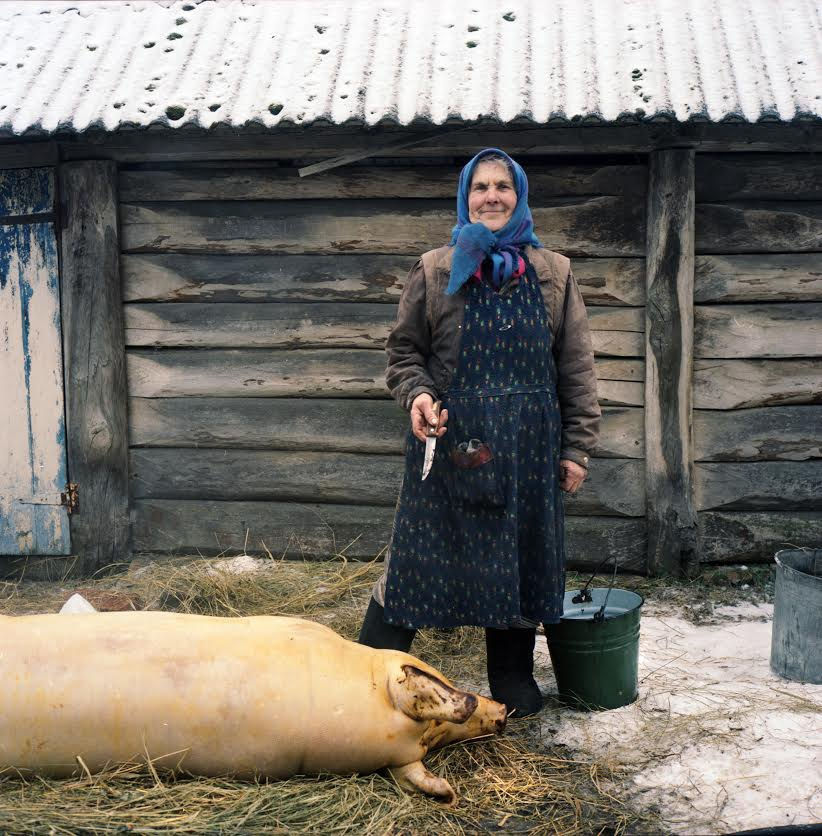 Woman with slaughtered pig
