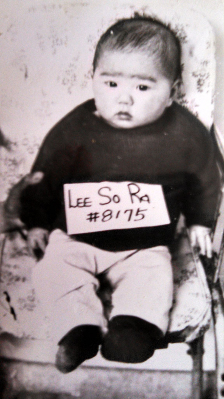 My adoption photo in Korea, with my adoption number #8175.