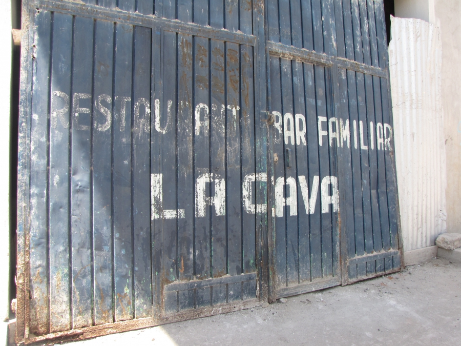 The outside door of the bar Mona worked in after arriving in Frontera Comalapa, Mexico.