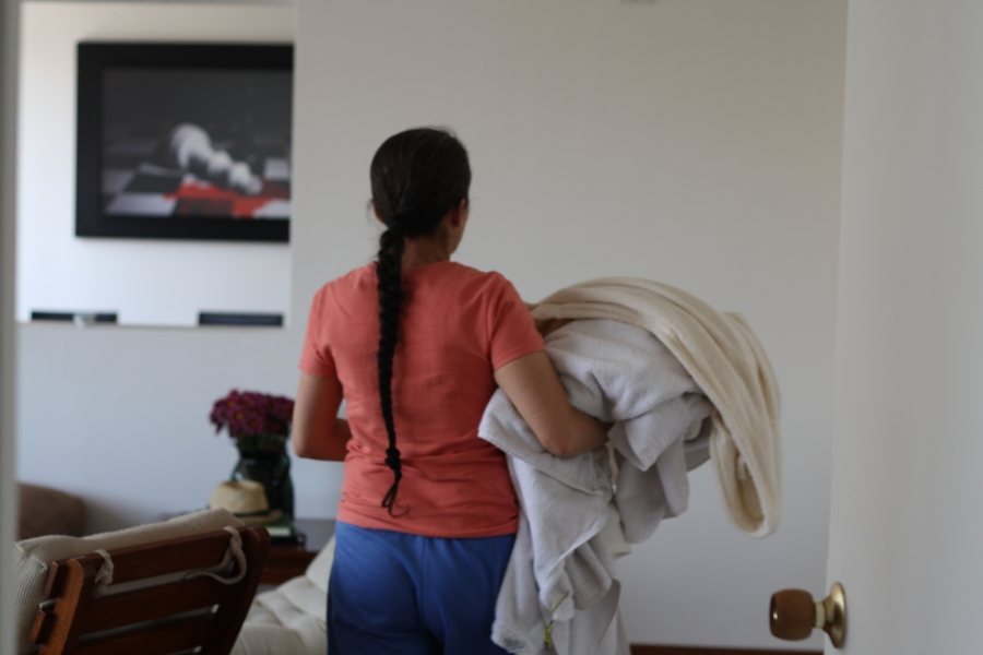 Belén García carries laundry