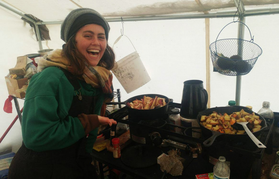 Campers cook in a tent