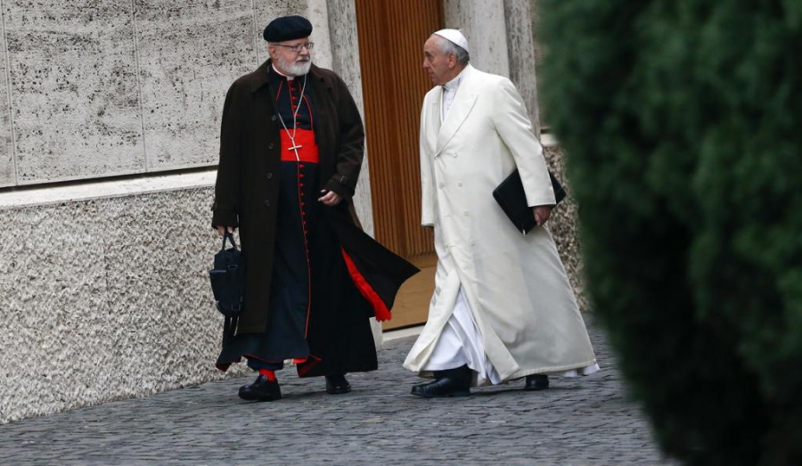 Pope Francis talks with Cardinal Sean Patrick O'Malley as they arrive at the Vatican on Feb. 13, 2015.
