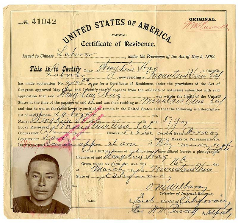 Printed on yellow paper and with a photograph in the lower lefthand corner, a certificate of residency includes biographical, residential, and employment information of a Chinese laborer living in California in the early 1890s