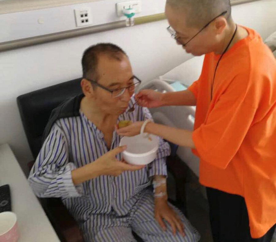 Chinese democracy activist Liu Xiaobo, imprisoned on the charge of subverting state power and suffering from terminal liver cancer, is fed by his wife Liu Xia on a rare visit, shortly before he died on July 13, 2017.
