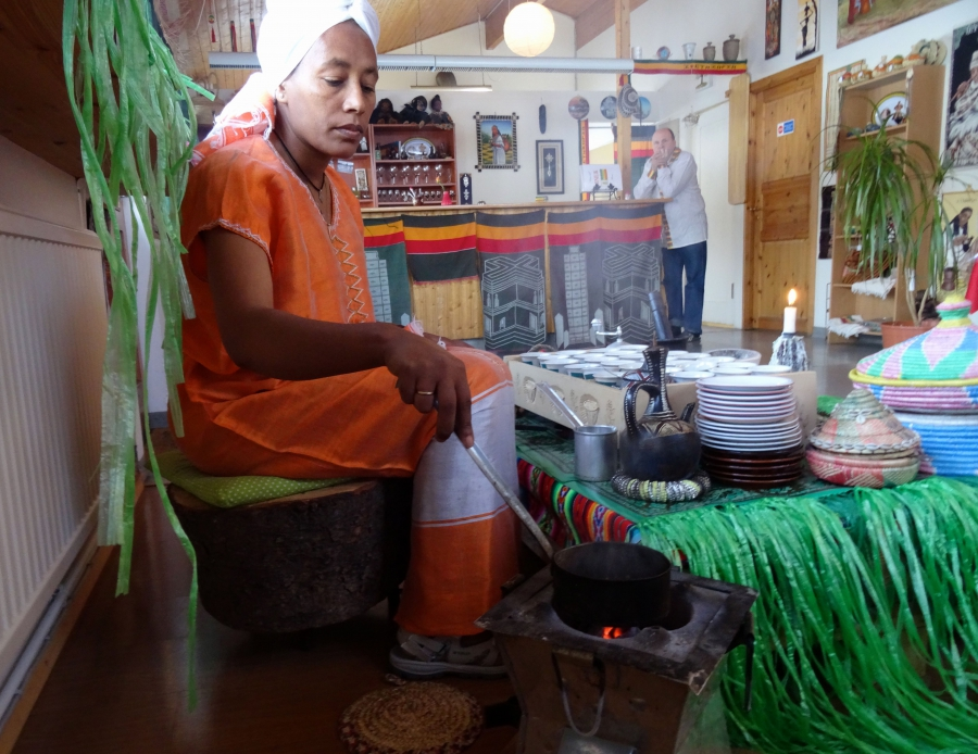 Azeb Kahssay roasts coffee beans in Minilik, the Ethiopian restaurant she co-owns in Flúðir, Iceland.