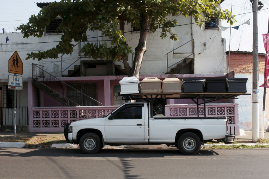 A pick-up truck transports unfinished coffins to another workshop in Jucuapa.
