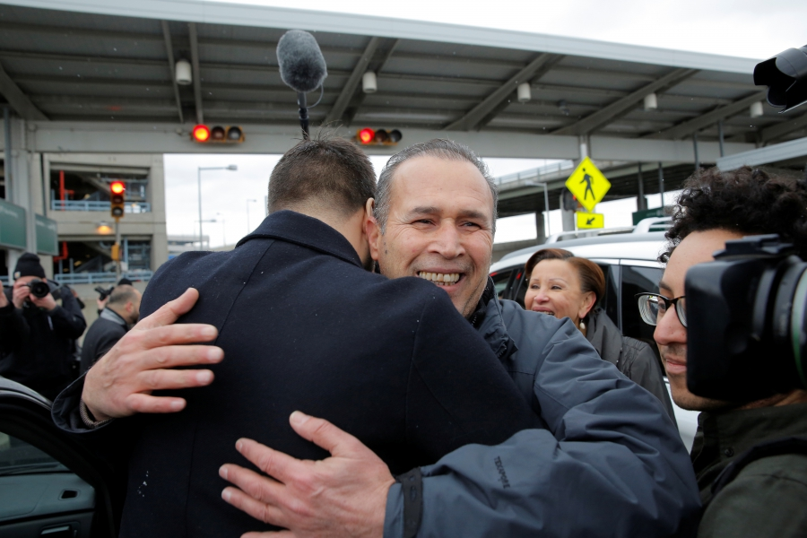 Hameed Darweesh, and Iraqi man who worked as a translator for the US Army, is embraced after being released at John F. Kennedy International Airport in Queens, New York, Jan. 28, 2017.