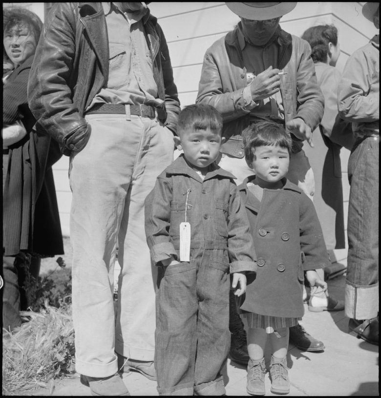Two young children in traveling clothes