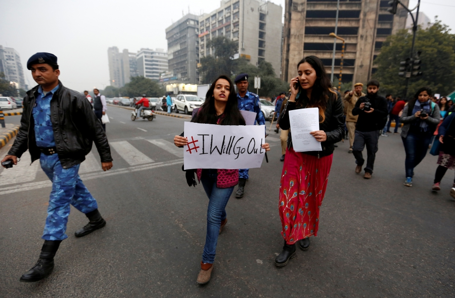 Women take part in the #IWillGoOut rally, organized to show solidarity with the Women's March in Washington, along a street in New Delhi, India