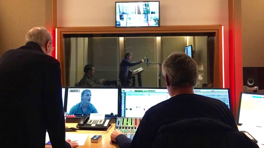 Inside the EuroSync studios in Berlin, German voice actor Victor Neumann (far center) voices the part of Rick Grimes on The Walking Dead, while dubbing director Hans-Jürgen Wolf and an engineer look on.